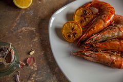 Black tiger prawns with caramelised lemon. Food photography, fried black tiger prawns with garlic and caramelised lemons Stock Photo