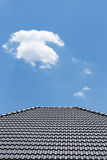 Black tile roof on house with clear blue sky and cloud Royalty Free Stock Images