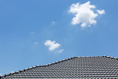 Black tile roof on house with clear blue sky and cloud Stock Photo