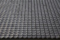 Black tiled roof for background usage Stock Images