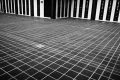 Black tiles floor with white lines, abstract with nobody. Black tiles floor with white lines, abstract background with nobody, geometry and perspective Royalty Free Stock Image