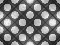 Black tiles with a gray round Stock Image