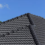 Black tiles roof on a new house Stock Photography