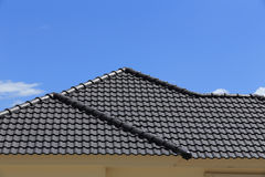 Black tiles roof on a new house Stock Images