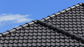 Black tiles roof on a new house Stock Image