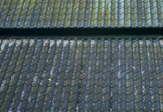 Black tiles roof on a old house Royalty Free Stock Image