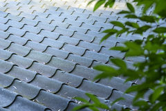 Black tiles roof on a old house Stock Photo