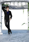 Black Tint Dandy. 3d render of handsome dandy in black suit outfit leaning on a column of an open white patio surrounded by blossoming ivy Stock Image
