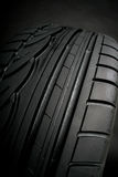 Black tire. Sport black car tire on black Stock Images