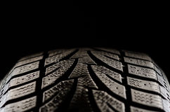 Black tire treads close up. Image of a rubber tire tread shot in studio Royalty Free Stock Photos
