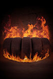 Black tires on the hot flame Royalty Free Stock Photo
