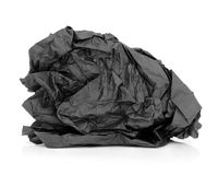 Black Tissue Paper. Crumpled black tissue paper over white background Royalty Free Stock Image