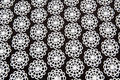 Black tissue with white round abstract figures Stock Photo