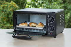 Black toaster oven. On natural background royalty free stock images