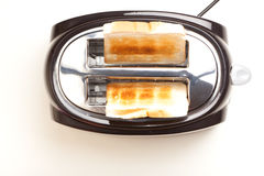 Black toaster, two toasted slices of bread Royalty Free Stock Images