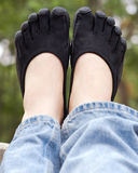 Black toe shoes on deck rail Royalty Free Stock Photo