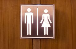 Black toilet sign , Cute man and lady  on Wood background Stock Photo