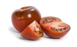 Black tomato. Black Prince Heirloom Tomato on white stock photo