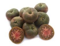 Black tomatoes in studio Royalty Free Stock Image