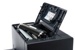 Black toner cartridge on a laser printer Royalty Free Stock Images