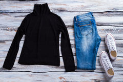 Black top with blue jeans. Royalty Free Stock Photography