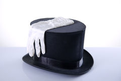 Black top hat with silk white gloves Stock Image