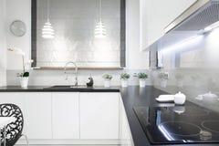 Black top in white kitchen Royalty Free Stock Photos