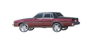 Black topped red four door sedan Royalty Free Stock Image