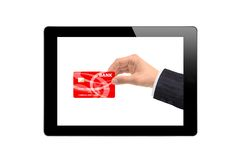 Black Touch Screen Tablet and hand with credit card Royalty Free Stock Photo