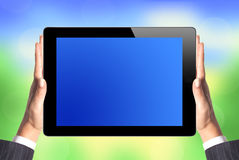 Black Touch Screen Tablet in woman hands over nature Royalty Free Stock Photo
