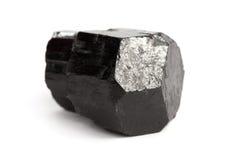 Black tourmaline crystal. Schor crystal, black variety of tourmaline, isolated on white royalty free stock image