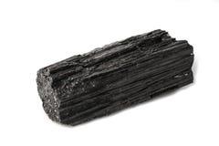 Black tourmaline piece. Black tourmaline stone placed on the white background. Horizontal studio shot stock photo