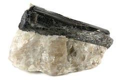 Black tourmaline. On quartz isolated on white background stock photography
