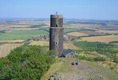Black tower of Hazmburk castle. View of the Black Tower and Slatina village from the top of the castle stock photos