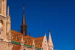 Black tower of the Late-Gotic Roman Catholic Matthias Church in Budapest royalty free stock images