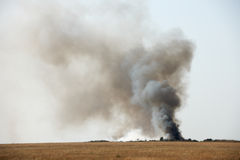 Black toxic smoke. Toxic black smoke from fire in dung-hill emitting poison in the air Stock Images