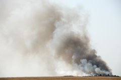Black toxic smoke. Toxic black smoke from fire in dung-hill emitting poison in the air royalty free stock photos