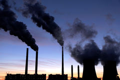 Black toxic smoke from coal power plant. During sunset stock photos