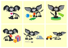 Black toy cats play with different objects Stock Images