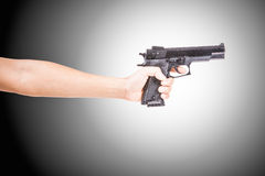 Black toy pistol in a hand Stock Photo