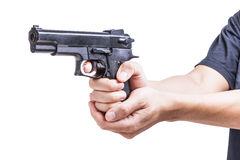 Black toy pistol in a hand Stock Photography