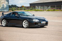 Black Toyota Supra goes down the street Stock Images