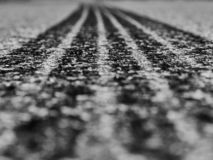 black track of tires of cars on asphalt stock photos