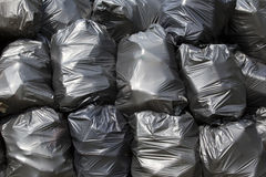 Black trash bags. A pile of black garbage plastic bags Stock Photo