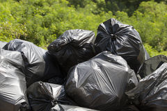 Garbage bags Stock Images