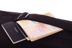 Black travel bag and passports Stock Photography