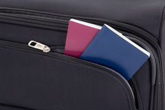 Black travel suitcase and two passports Royalty Free Stock Images