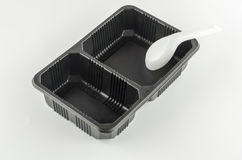 Black tray with spoon Royalty Free Stock Photography