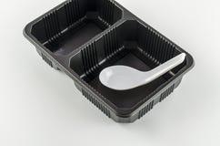 Black tray with spoon Royalty Free Stock Photo