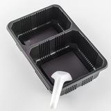 Black tray with spoon Royalty Free Stock Photos